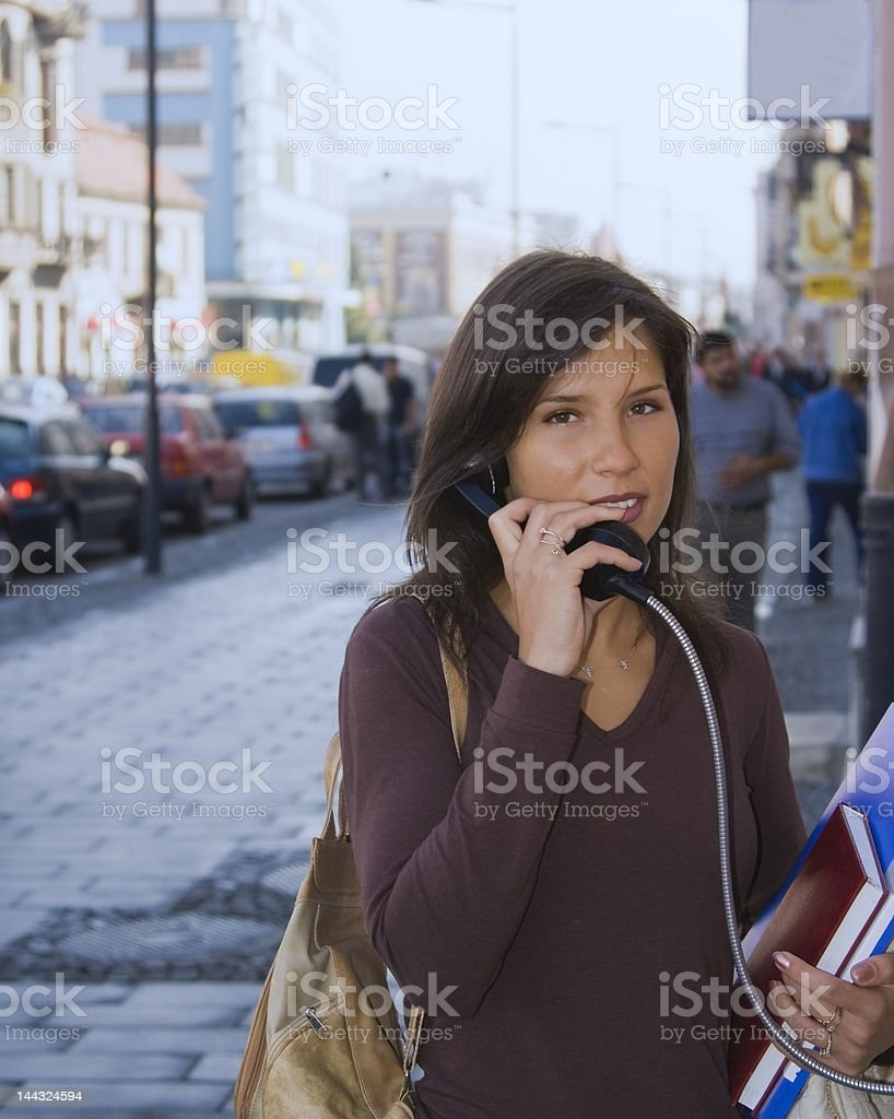 beautiful young woman using a telephone in an urban city royalty-free stock photo