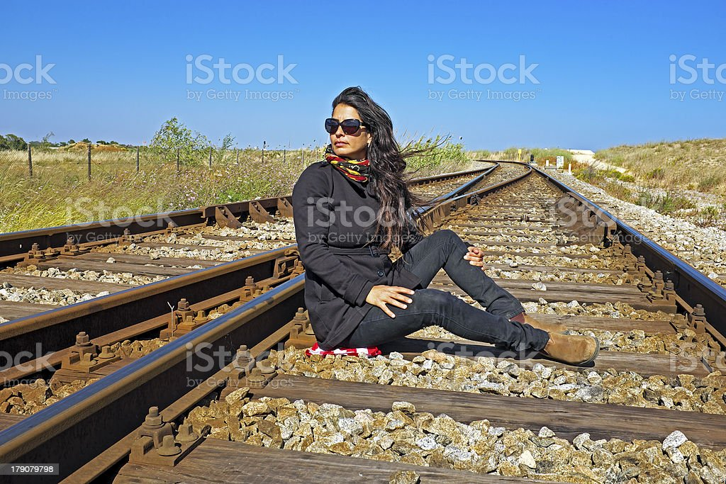 Beautiful young woman waiting for the train royalty-free stock photo