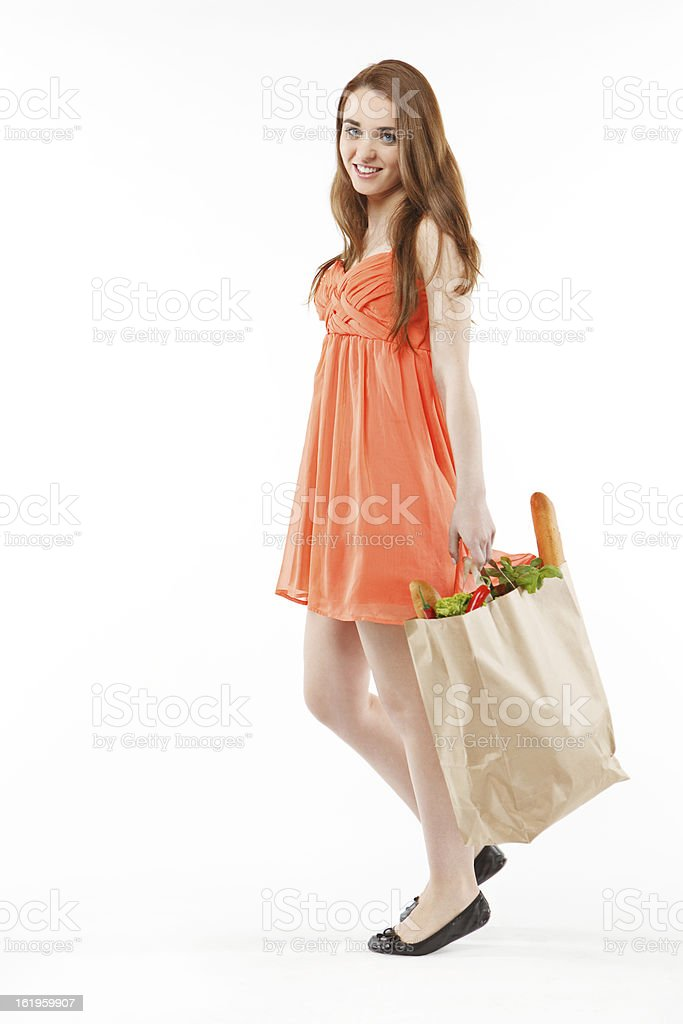 Beautiful young woman walking with shopping, on white background royalty-free stock photo