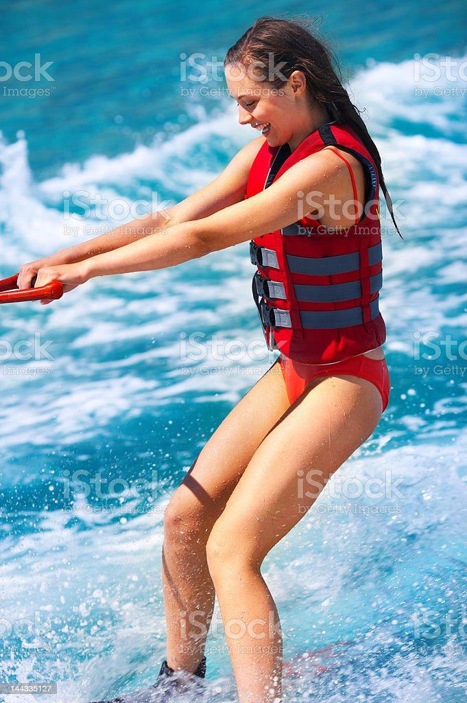 Beautiful young woman water skiing royalty-free stock photo