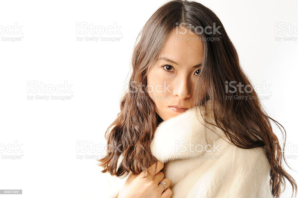 Beautiful young woman wearing a white mink coat royalty-free stock photo