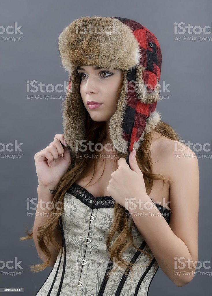 Beautiful Young Woman wearing Fur Hat.Winter Style stock photo