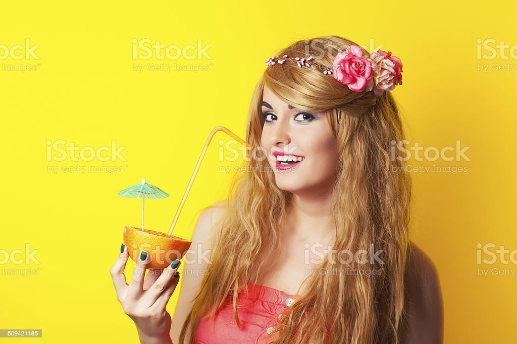 beautiful young woman wearing wreath and holding a cocktail made stock photo