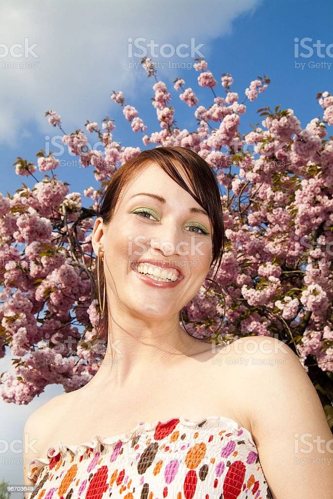 Beautiful young woman with a blossom smile stock photo