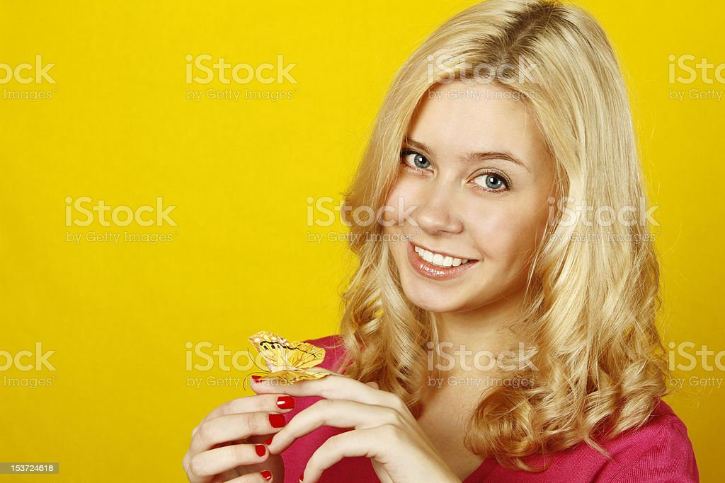 Beautiful young woman with a butterfly royalty-free stock photo