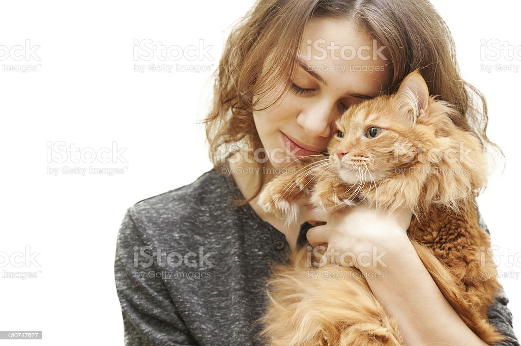 beautiful young woman with a cat royalty-free stock photo