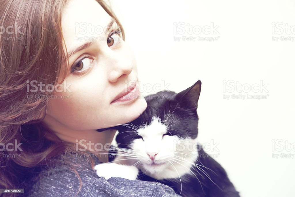 beautiful young woman with a cat stock photo