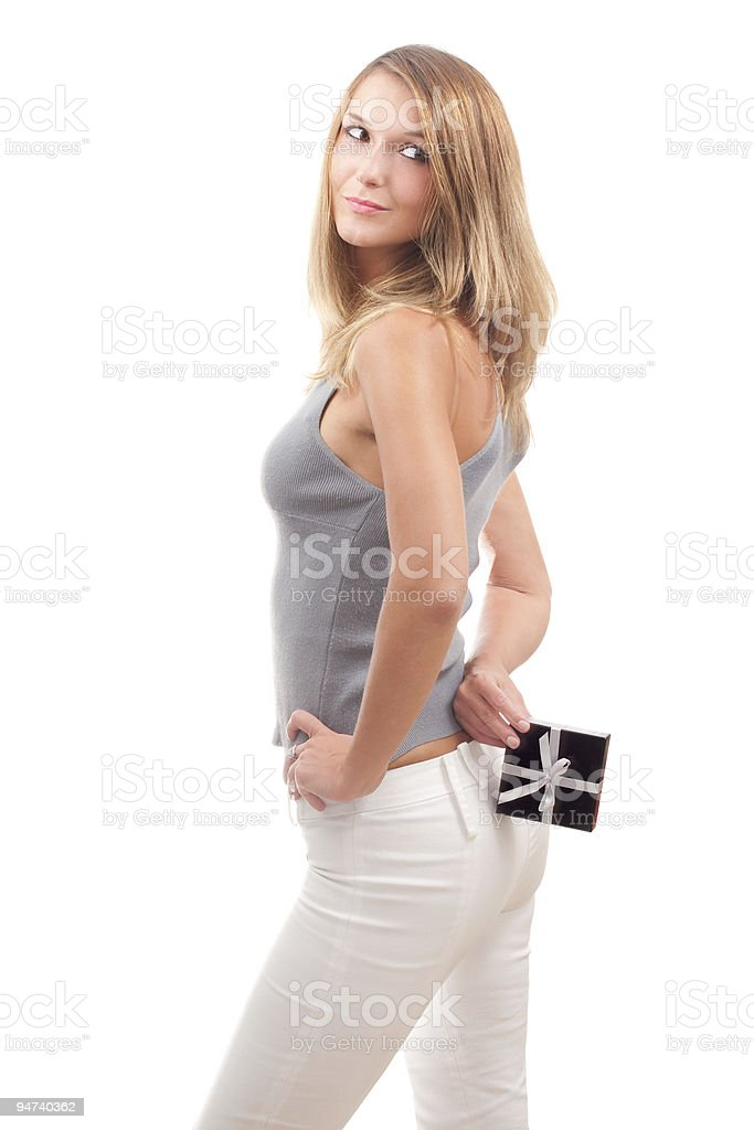 Beautiful young woman with a gift box royalty-free stock photo