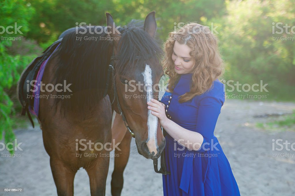 Beautiful young woman with a horse royalty-free stock photo