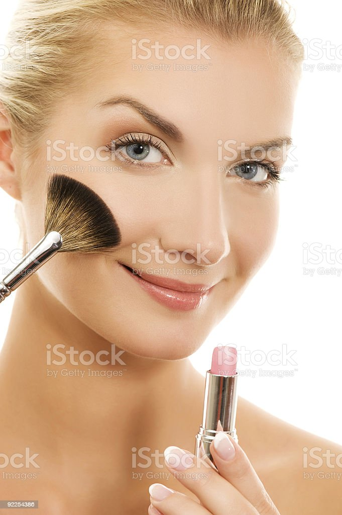 Beautiful young woman with a make-up brush. royalty-free stock photo