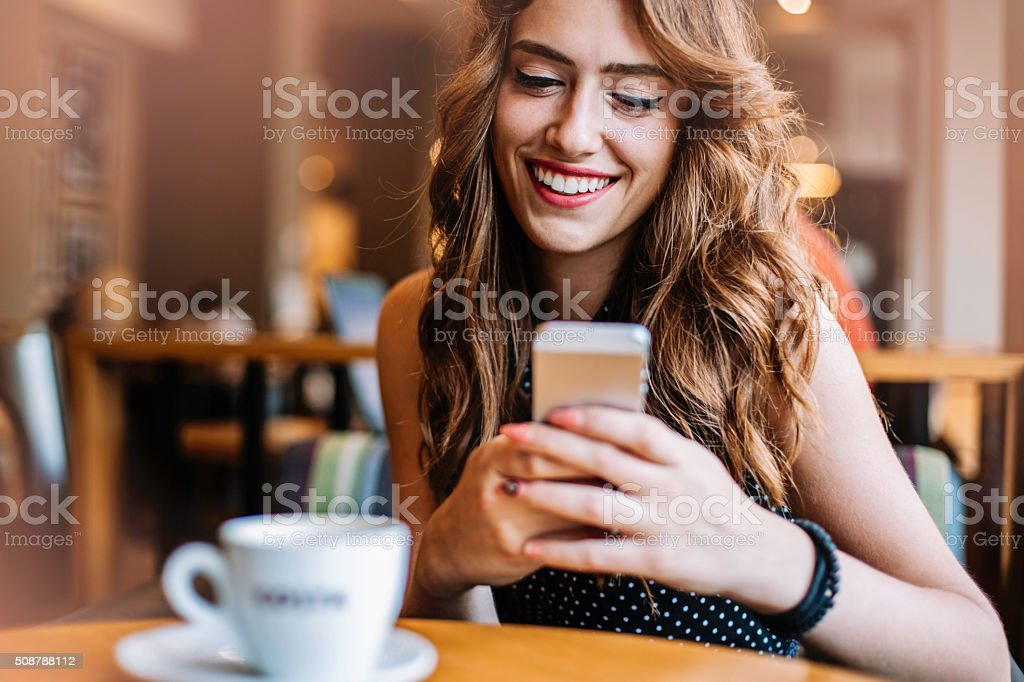 Beautiful young woman with a mobile phone stock photo