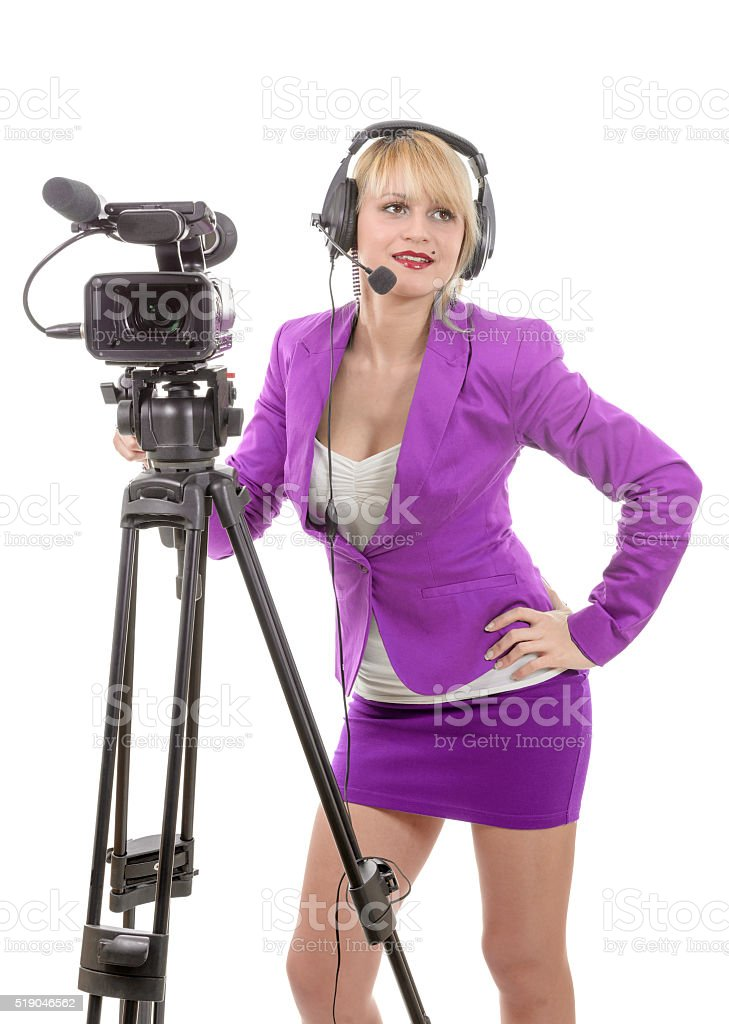 beautiful young woman with a professional video camera stock photo