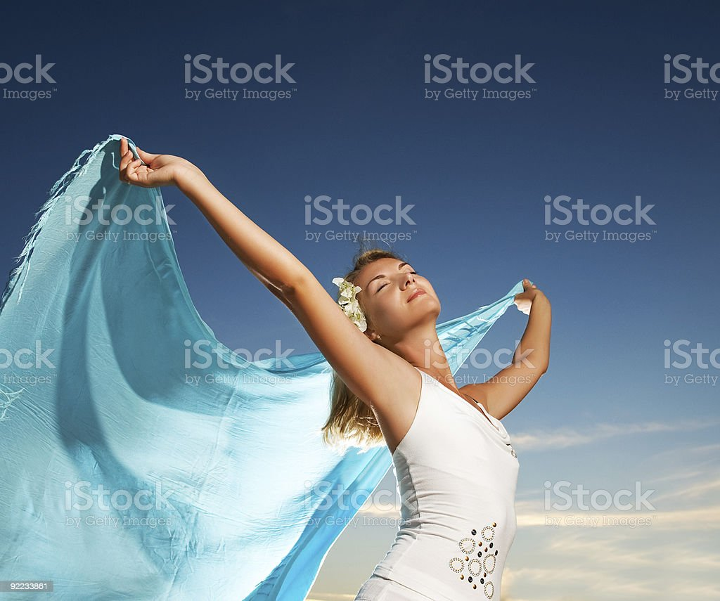 Beautiful young woman with a shawl relaxing outdoors royalty-free stock photo