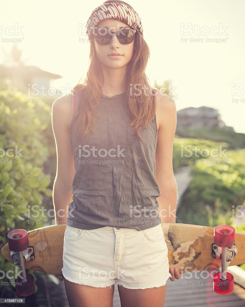 Beautiful young woman with a skateboard royalty-free stock photo