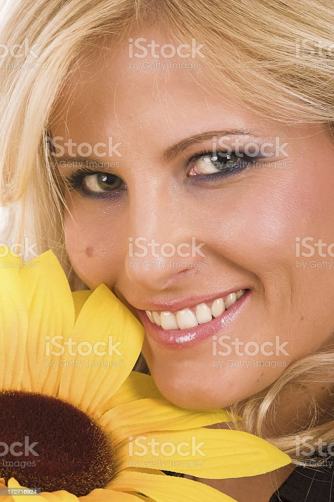 Beautiful young woman with a sunflower royalty-free stock photo