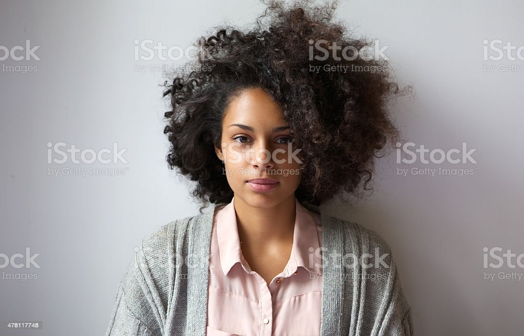 Beautiful young woman with afro hairstyle stock photo