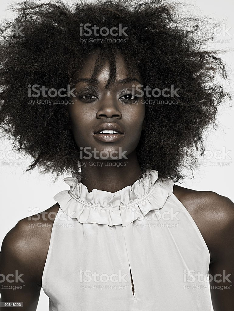 Beautiful young woman with an afro stock photo
