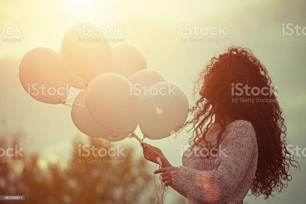 Beautiful young woman with balloons stock photo