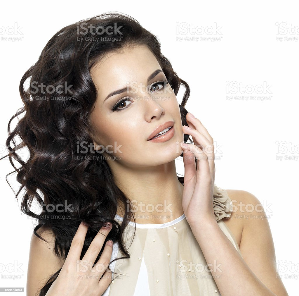 Beautiful young woman with beauty long curly hair. royalty-free stock photo