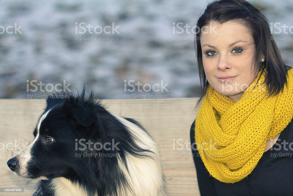 Beautiful young woman with best friend dog in winter royalty-free stock photo