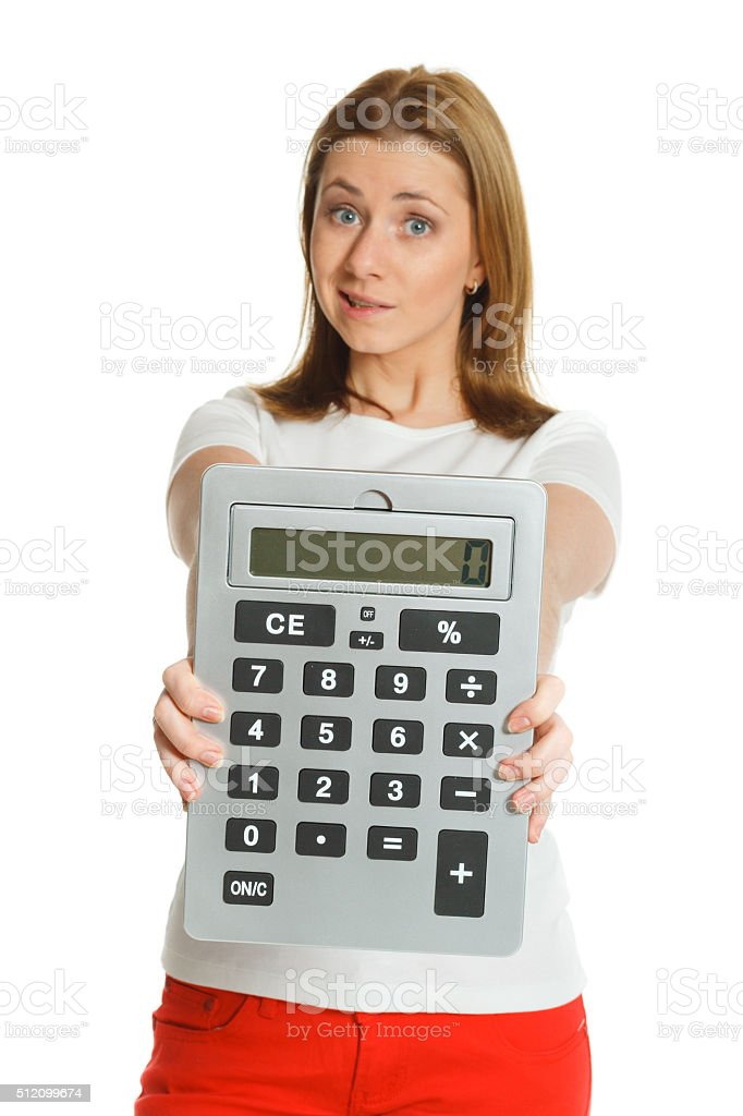 beautiful young woman with big calculator stock photo