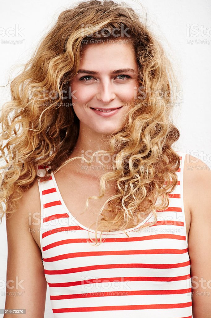 Beautiful young woman with blond curls, portrait stock photo