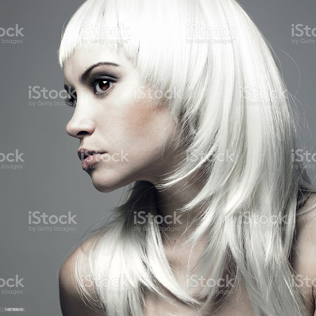 Beautiful young woman with blond hair stock photo