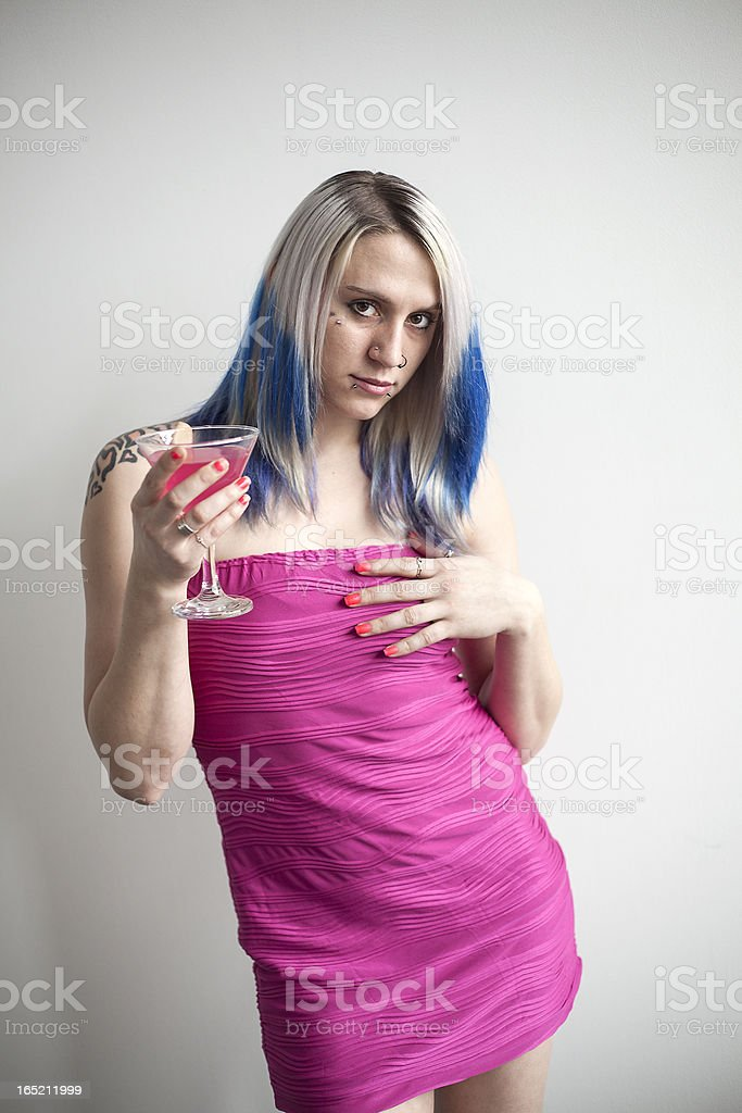 Beautiful Young Woman with Blue Hair and Pink Dress royalty-free stock photo