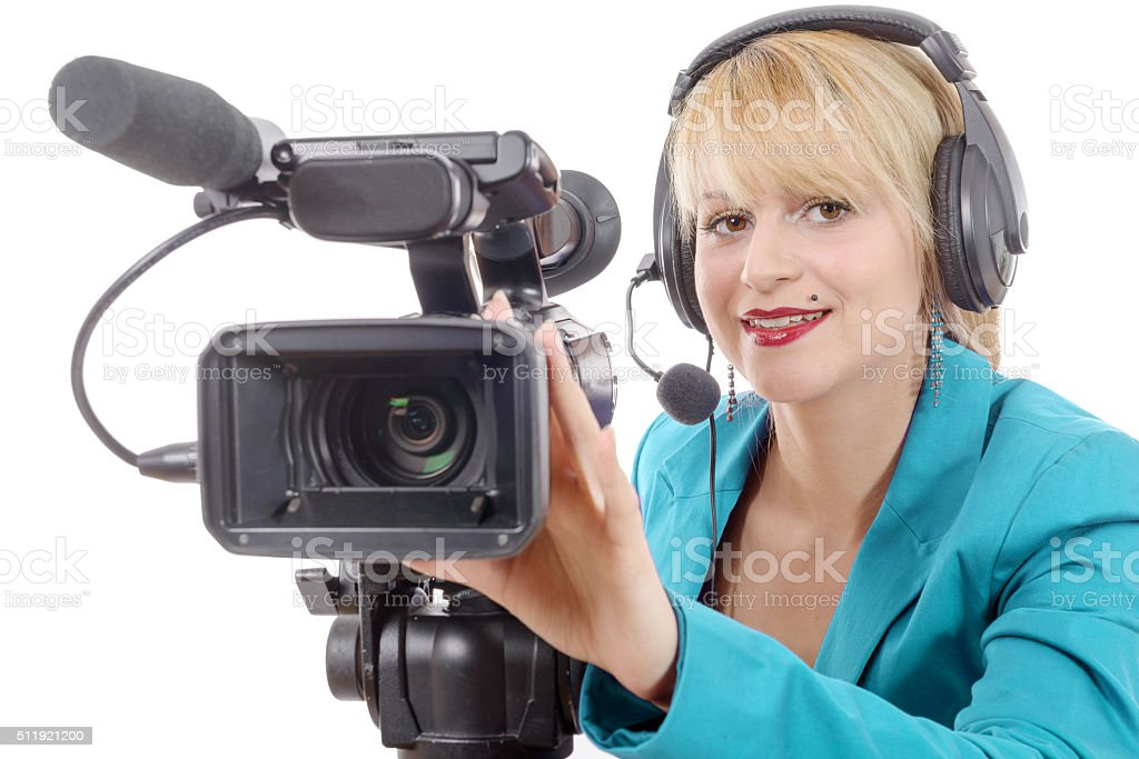 beautiful young woman with blue suit and camera stock photo