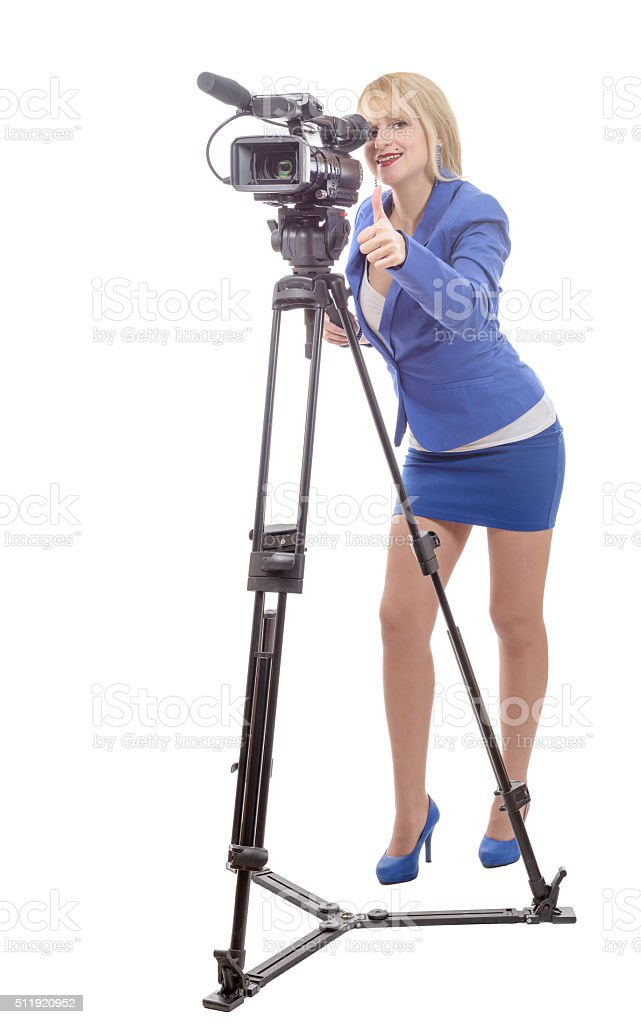 beautiful young woman with blue suit and professional video came stock photo