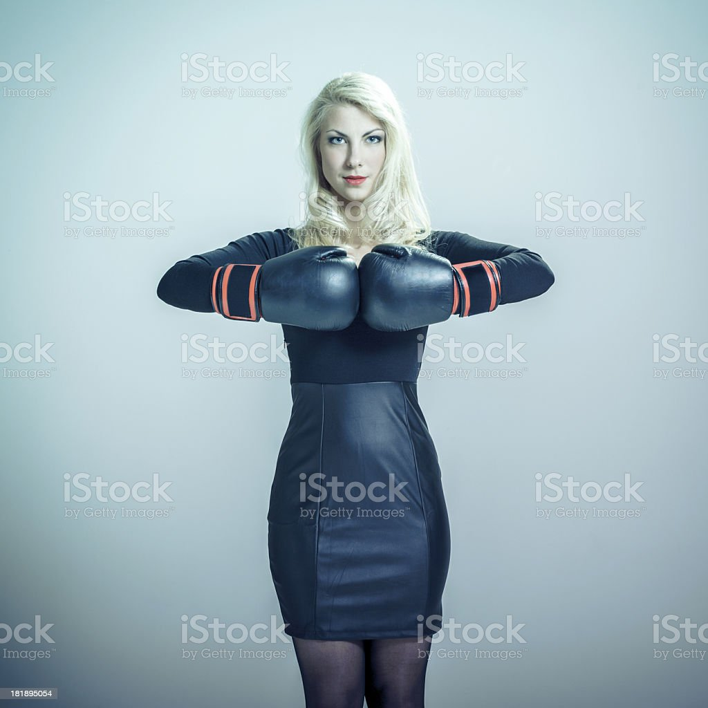 Beautiful young woman with boxing gloves royalty-free stock photo