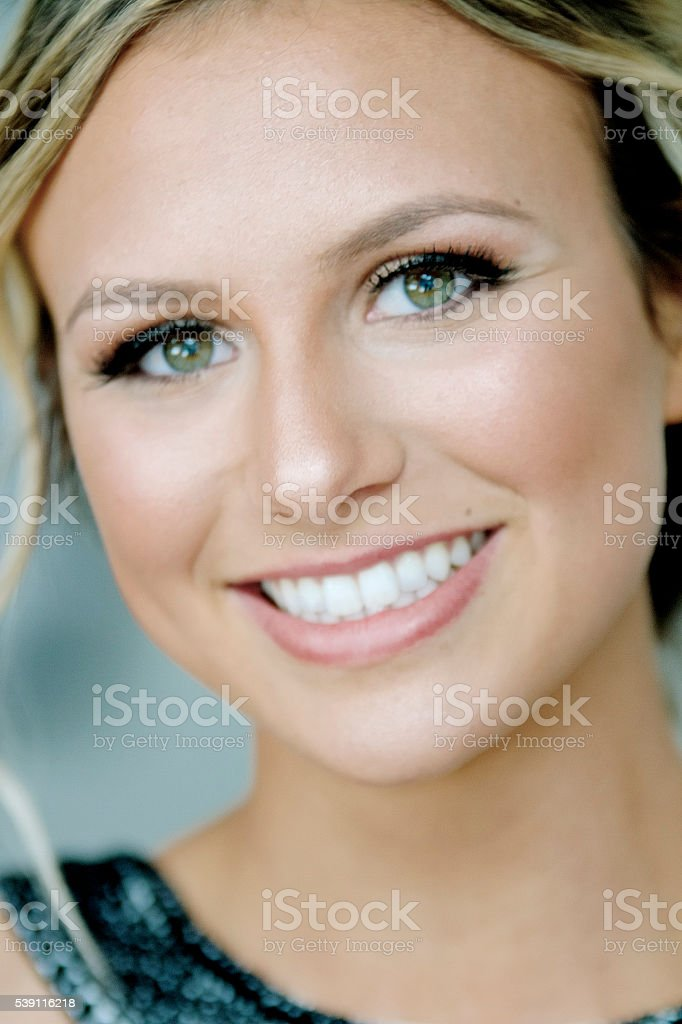 Beautiful young woman with bright white smile stock photo