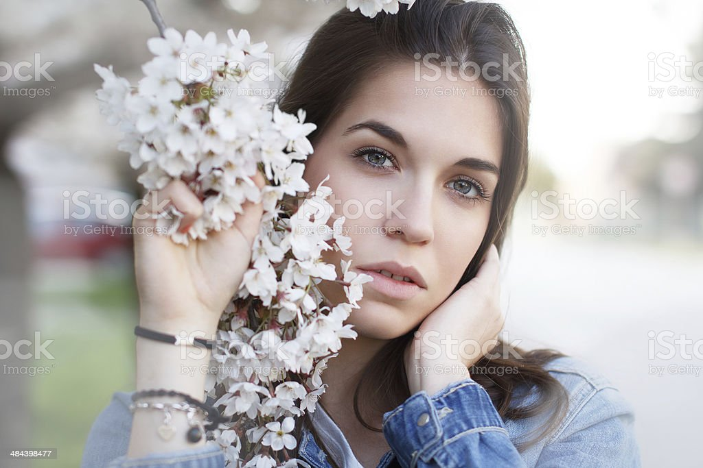 Beautiful young woman with cherry flower royalty-free stock photo