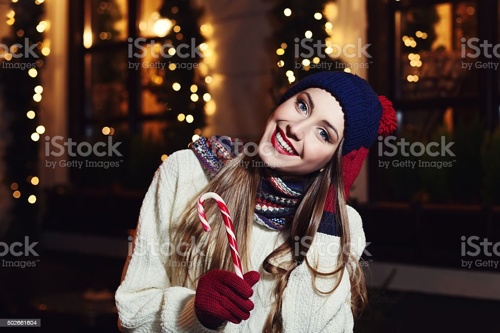 beautiful young woman with Christmas candy cane. stock photo