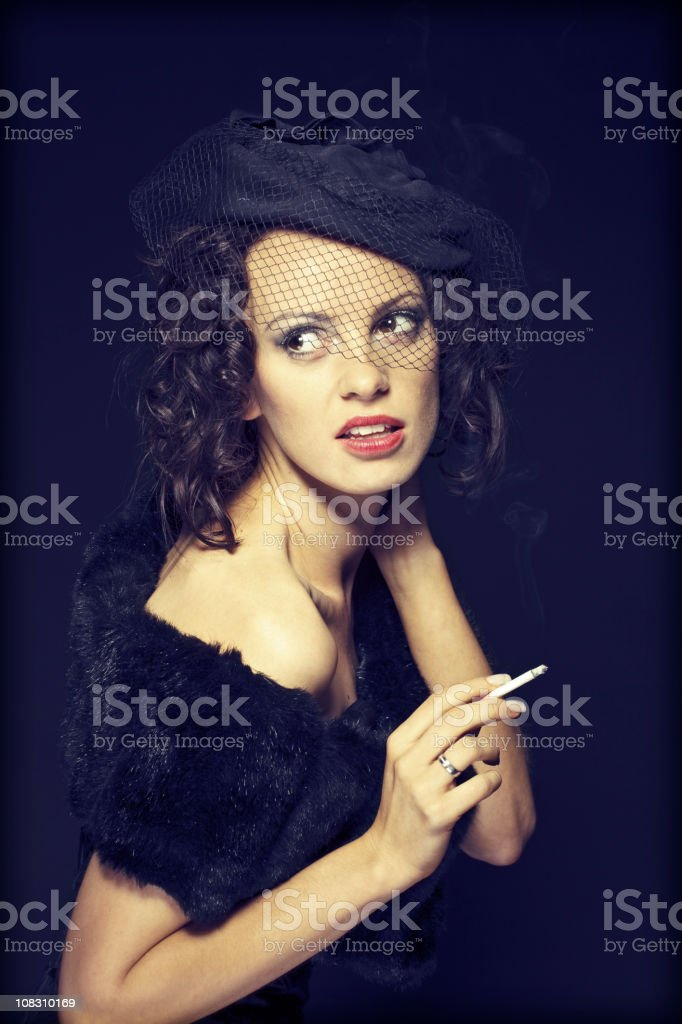 beautiful young woman with cigar royalty-free stock photo