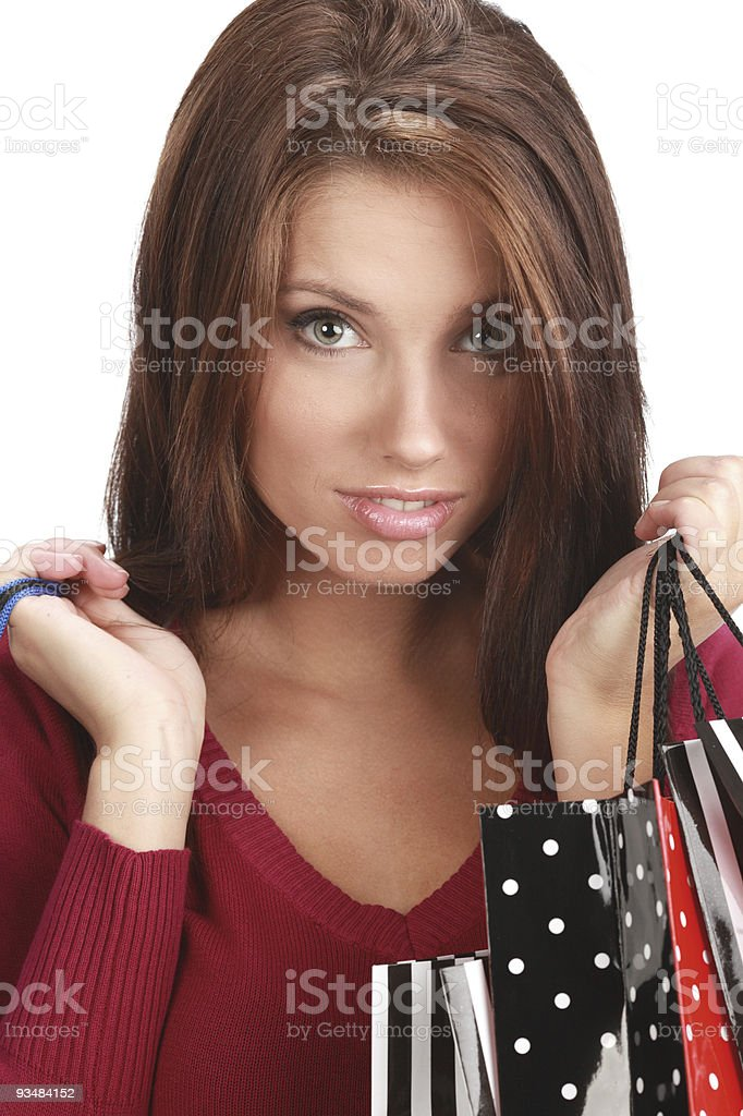 Beautiful, young woman with colorful shopping bags stock photo