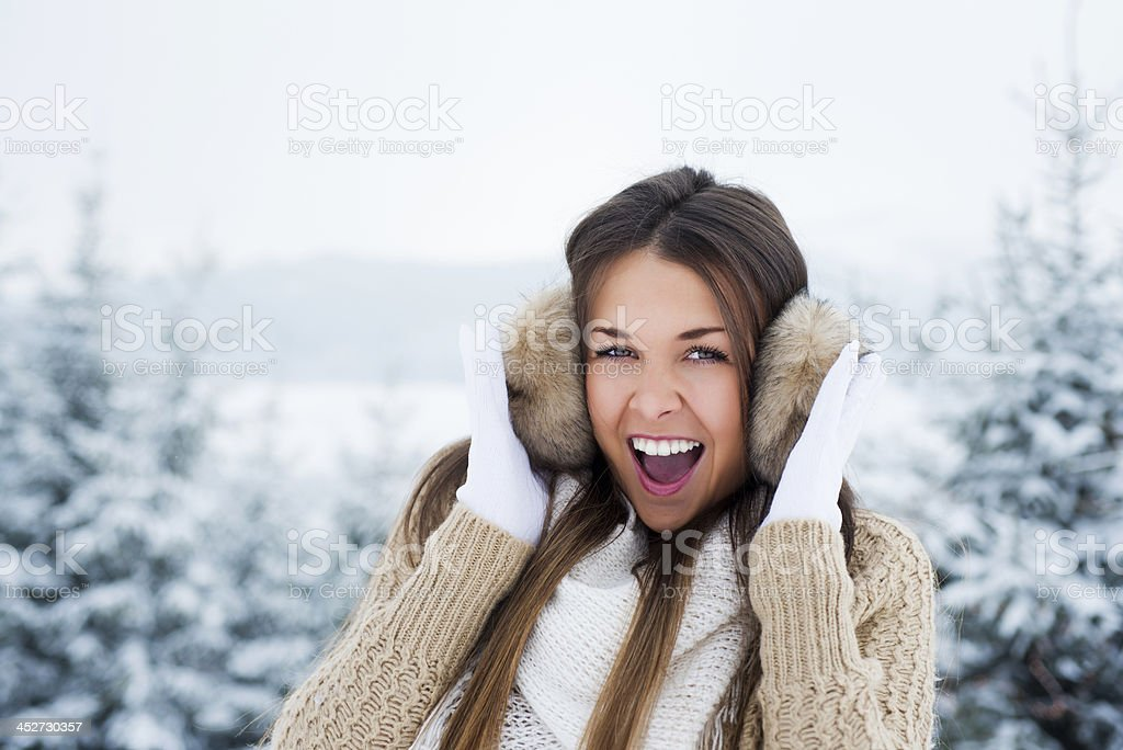 Beautiful young woman with ear muff stock photo