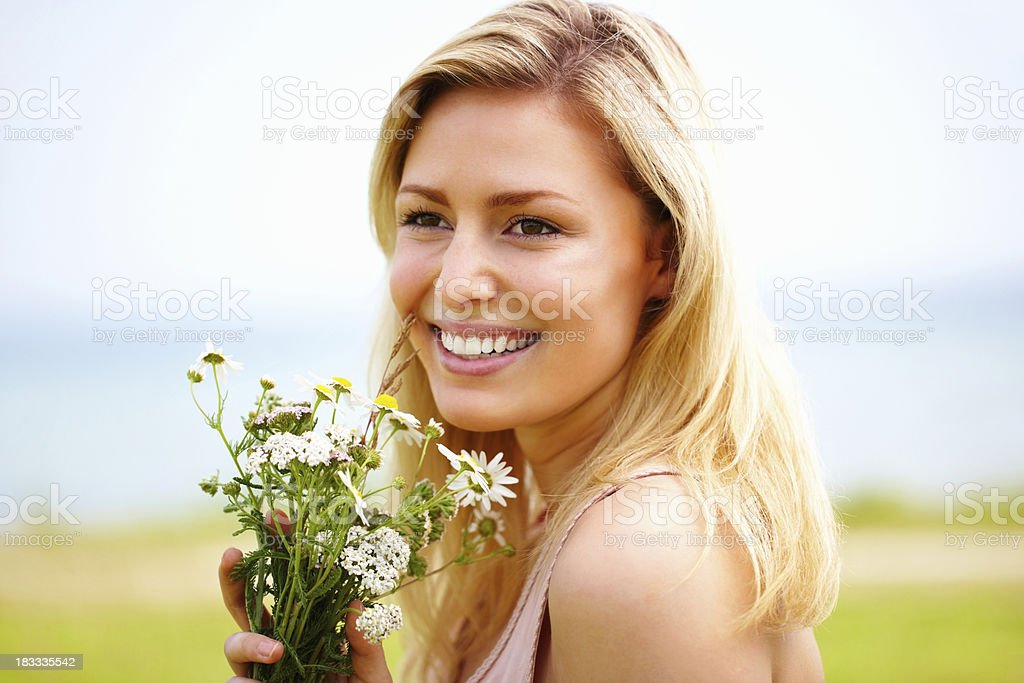 Beautiful young woman with flowers smiling royalty-free stock photo