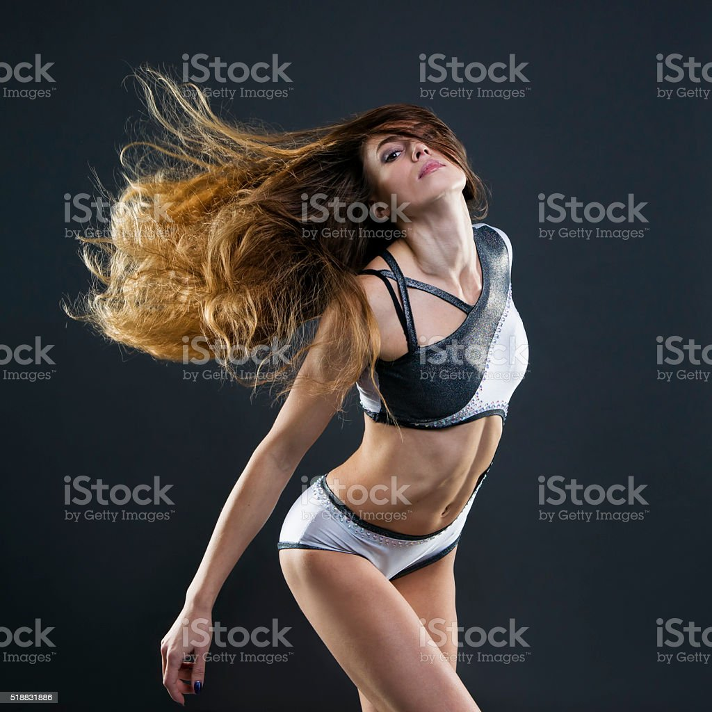 Beautiful young woman with flowing hair in studio stock photo