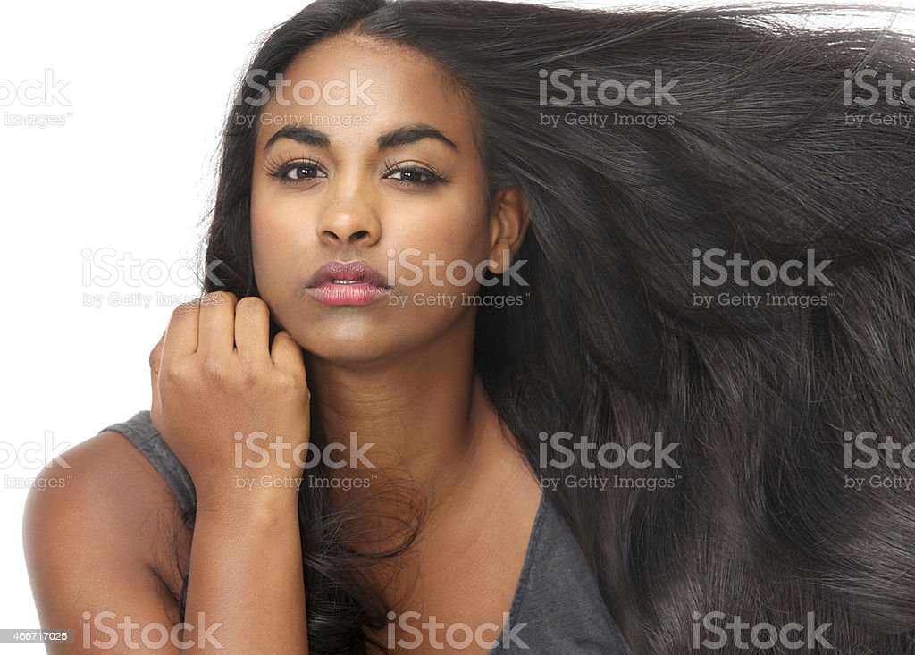 Beautiful young woman with flowing hair stock photo