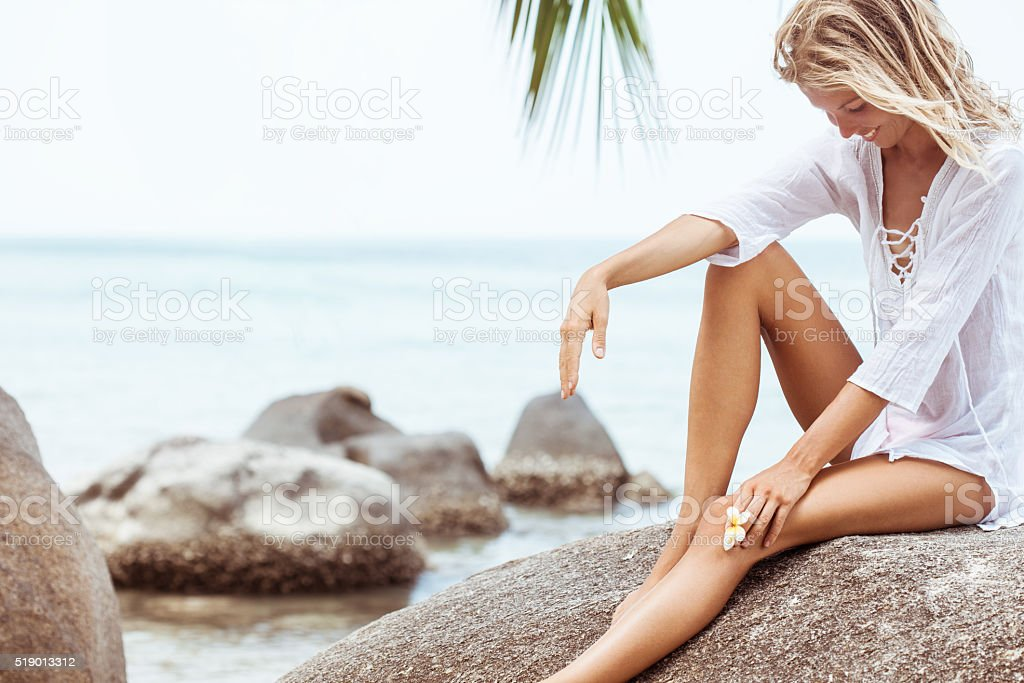 Beautiful young woman  with frangipani flower stock photo