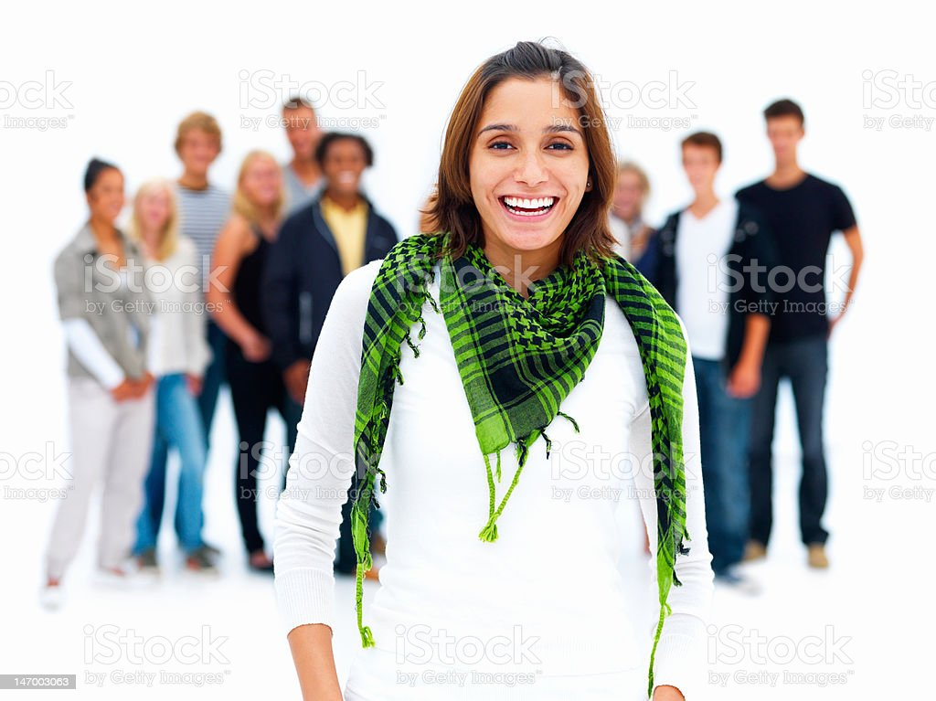 Beautiful young woman with friends in the background royalty-free stock photo