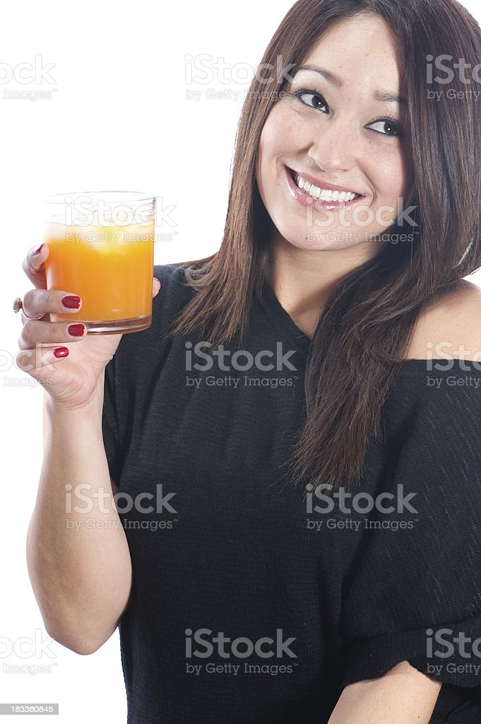 Beautiful young woman with glass of orange juice royalty-free stock photo