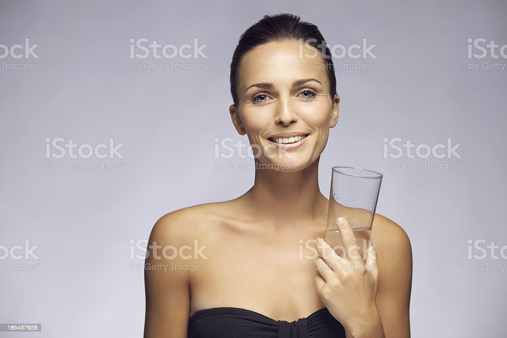 Beautiful young woman with glass of water royalty-free stock photo