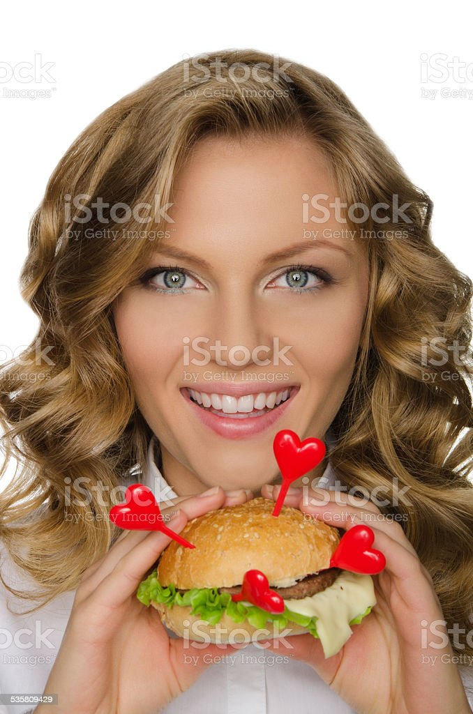 Beautiful young woman with hamburger from hearts stock photo