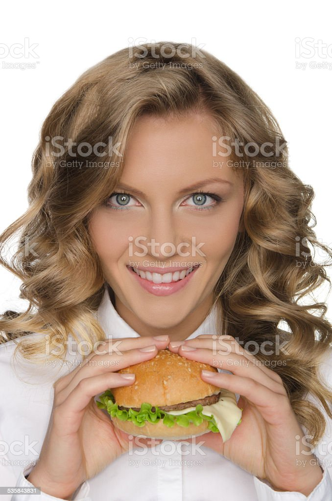 Beautiful young woman with hamburger stock photo