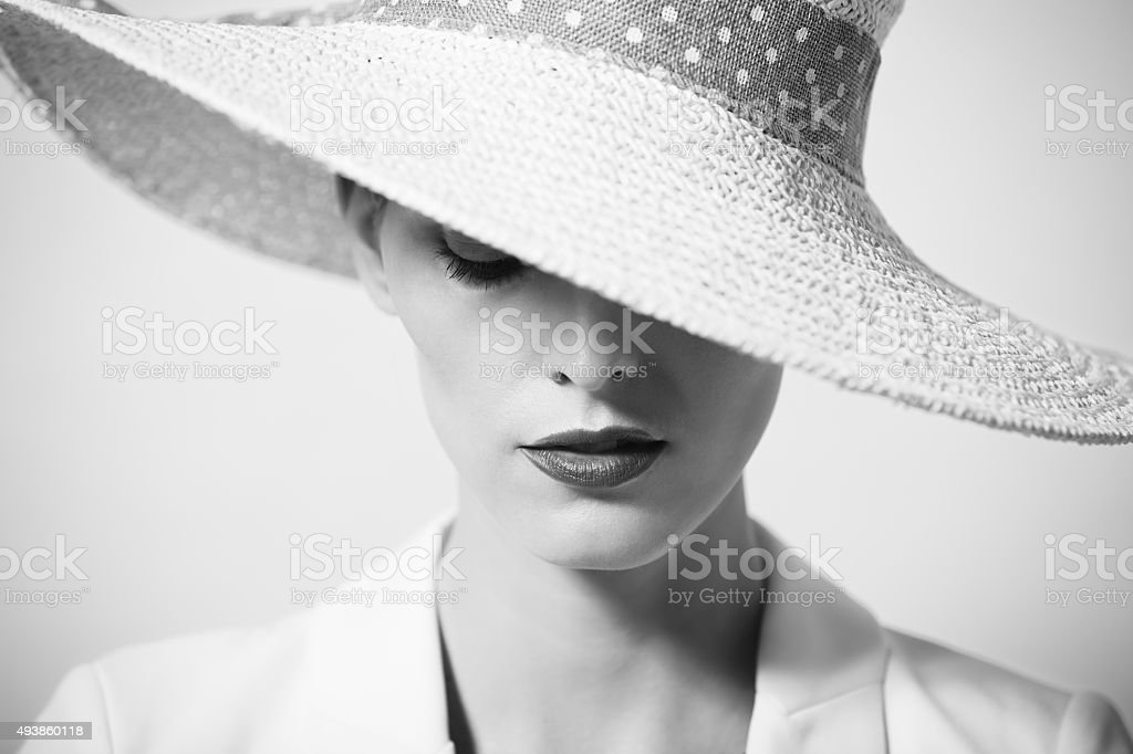 Beautiful young woman with hat stock photo