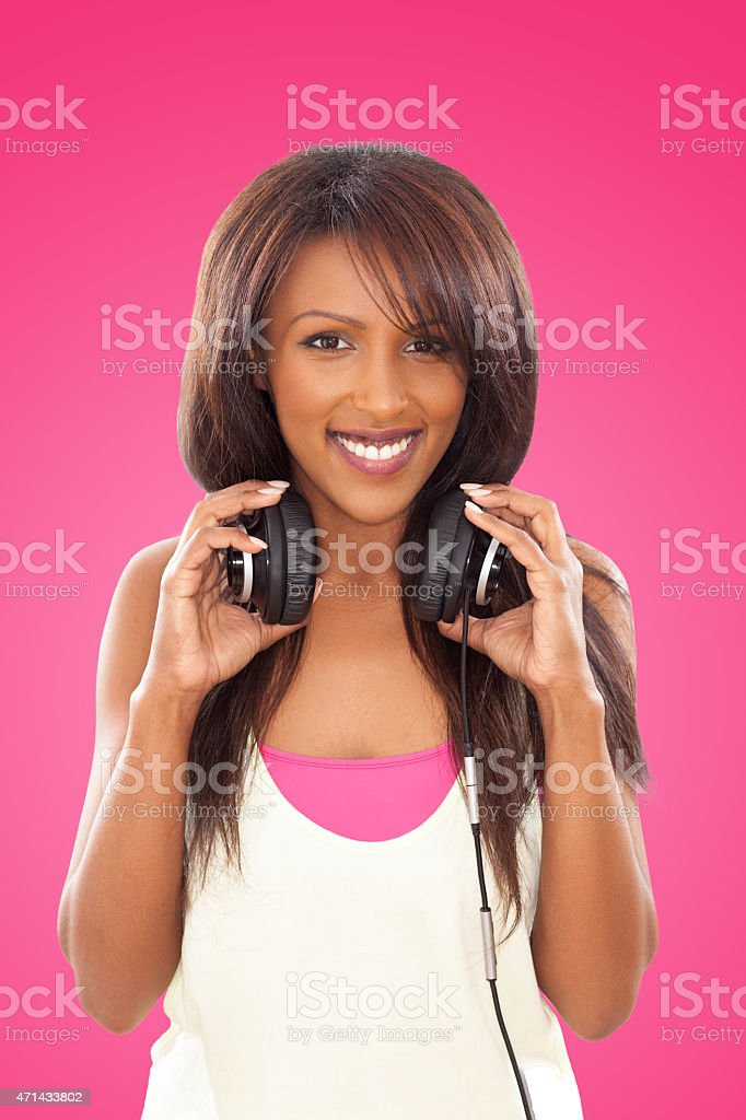 Beautiful young woman with headphones. stock photo