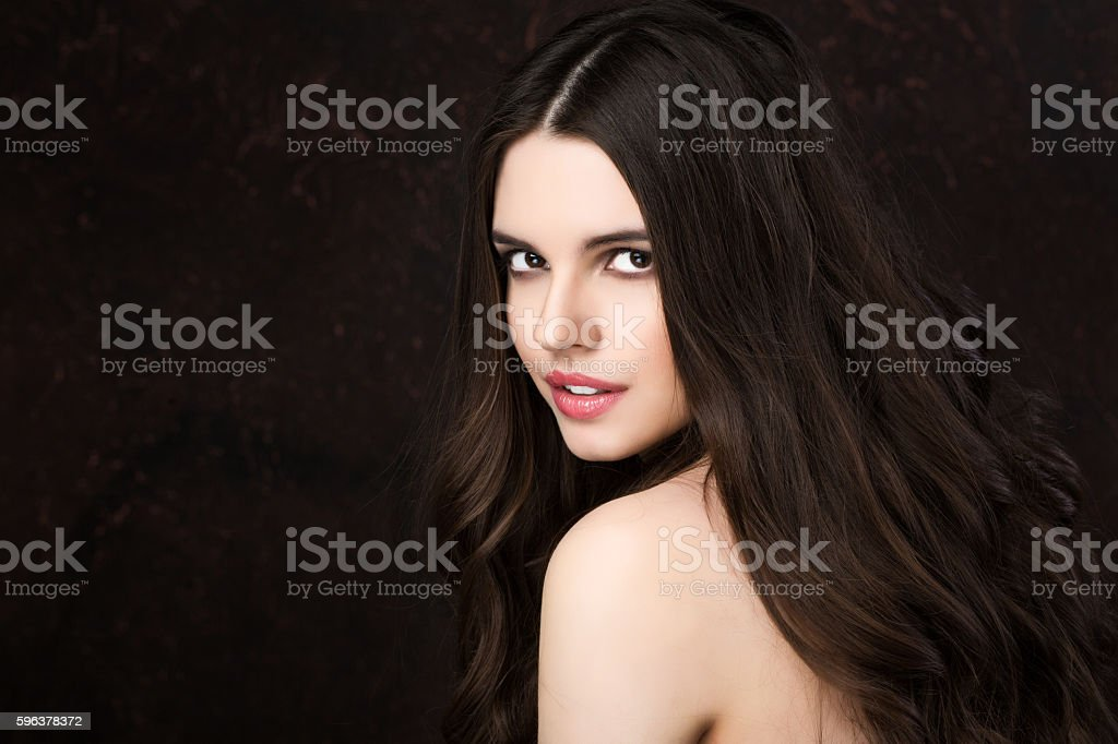 Beautiful young woman with healthy long hair. stock photo