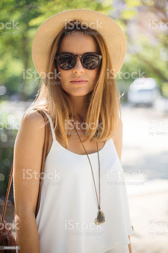 Beautiful young woman with hipster glasses looking at camera. stock photo